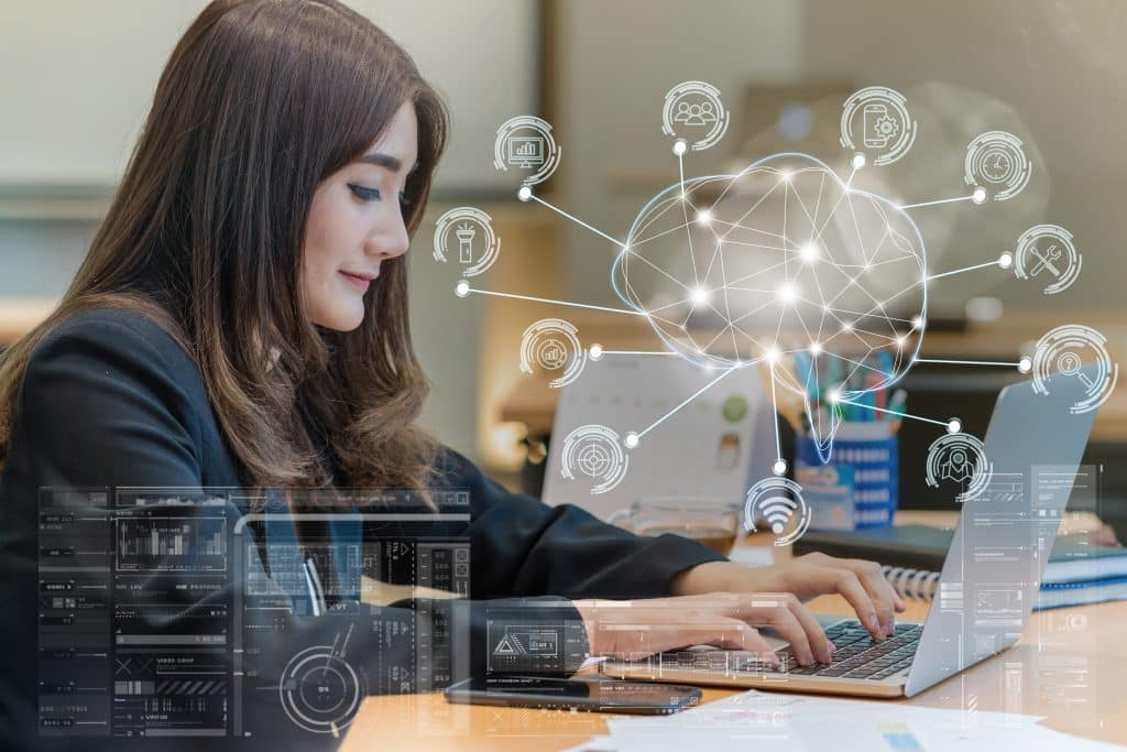 Asian businesswoman in formal suit working with computer laptop for Polygonal brain shape of an artificial intelligence with various icon of smart city Internet of Things, AI and business IOT concept
